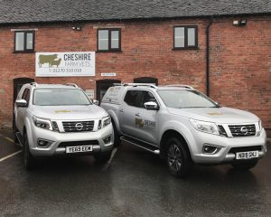 Signage and vehicles outside Cheshire Farm Vets